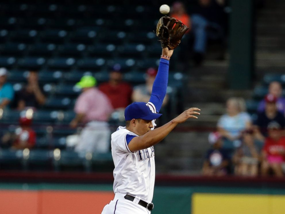 PHOTO: Texas Rangers second baseman Guilder Rodriguez leaps but is unable to grab a single by Los Angeles Angels Howie Kendrick, Sept. 9, 2014, in Arlington, Texas.