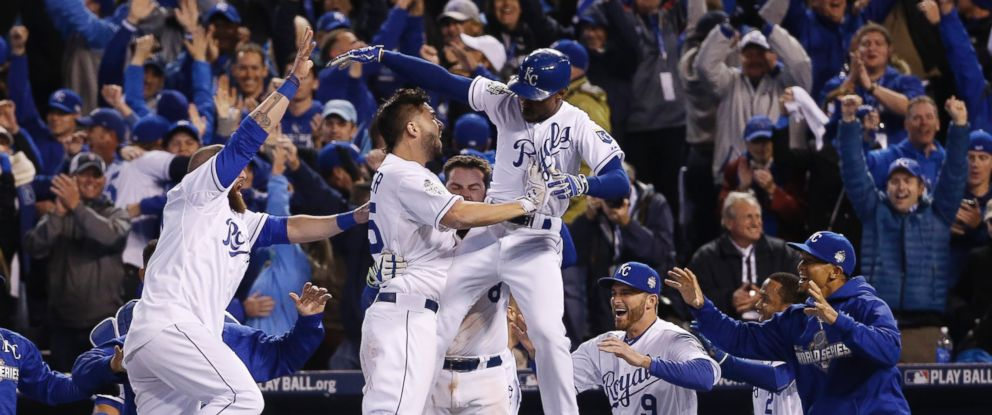 PHOTO: Kansas City Royals celebrate after Alcides Escobar (2) scored on a sacrifice fly by Eric Hosmer during the 14th inning of Game 1 of the Major League Baseball World Series against the New York Mets, Oct. 28, 2015, in Kansas City, Mo.