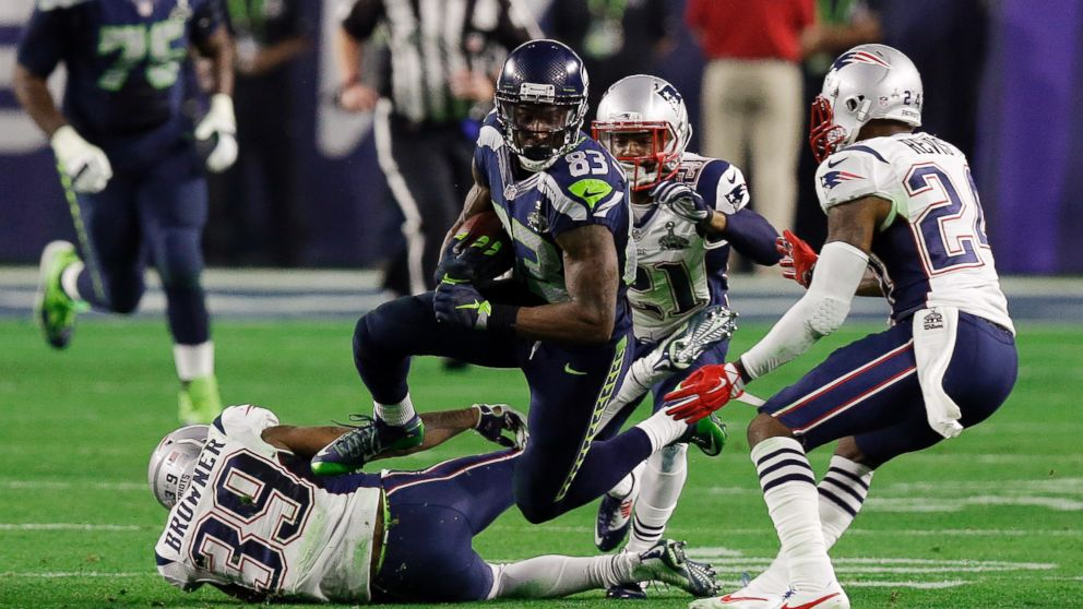 Seattle Seahawks wide receiver Ricardo Lockette leaps over New England  Patriots wide receiver Greg Orton during 431f086a1