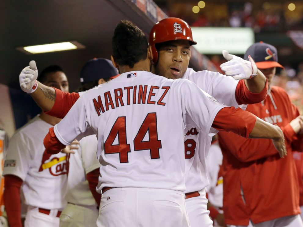 St. Louis Cardinals Oscar Taveras is congratulated by Carlos Martinez (44) after hitting a home run during the seventh inning in Game 2 of the National League baseball championship series against the San Francisco Giants Sunday, Oct. 12, 2014.