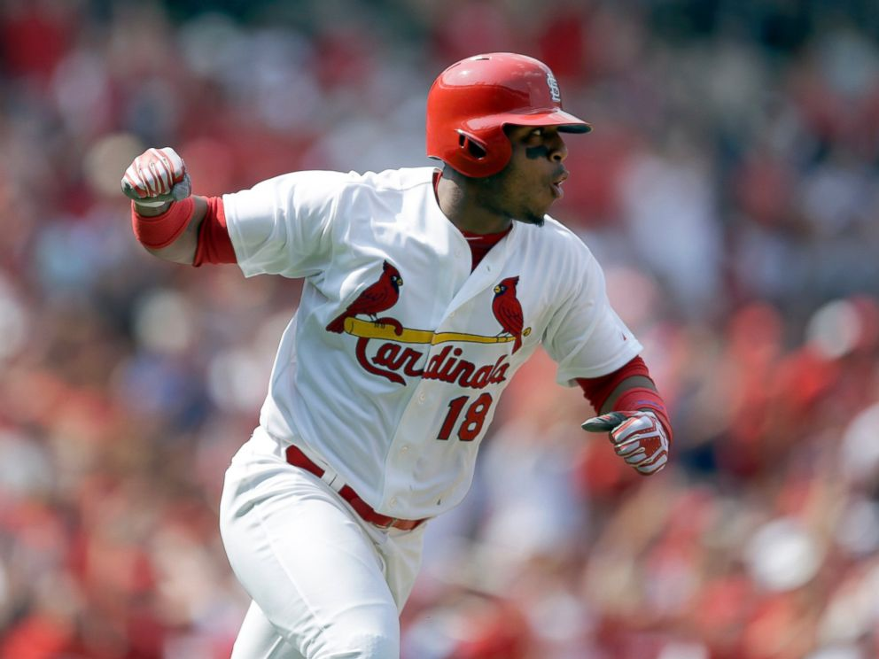 This Aug. 3, 2014 file photo shows St. Louis Cardinals Oscar Taveras pumping his fist as he runs down the first base line after hitting an RBI single during the seventh inning of a baseball game against the Milwaukee Brewers in St. Louis.