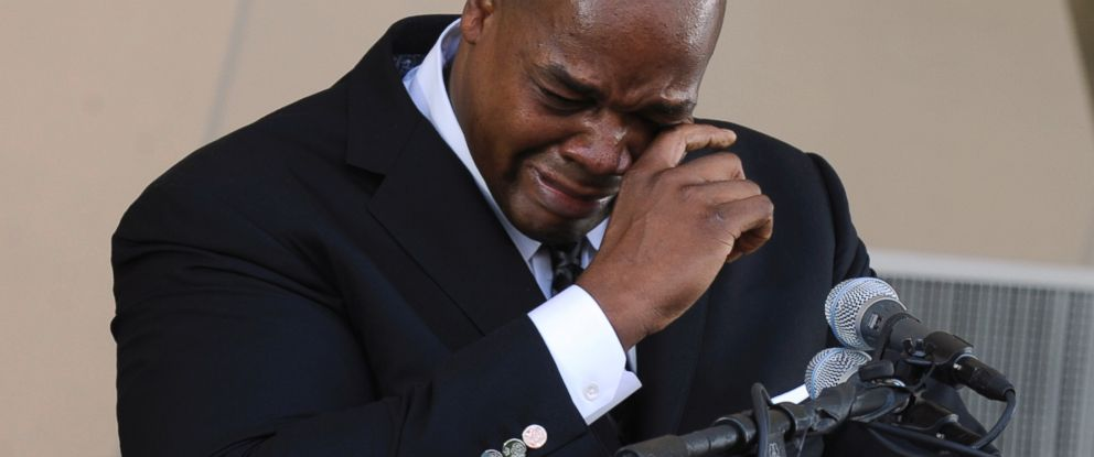 PHOTO: National Baseball Hall of Fame inductee Frank Thomas wipes away tears as he speaks during an induction ceremony at the Clark Sports Center, July 27, 2014, in Cooperstown, N.Y.