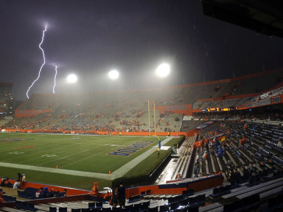 Lightning strikes near Ben Hill Griffin Stadium at Florida Field during a weather delay before an NCAA college football game between Florida and Idaho in Gainesville, Fla., Saturday, Aug. 30, 2014.