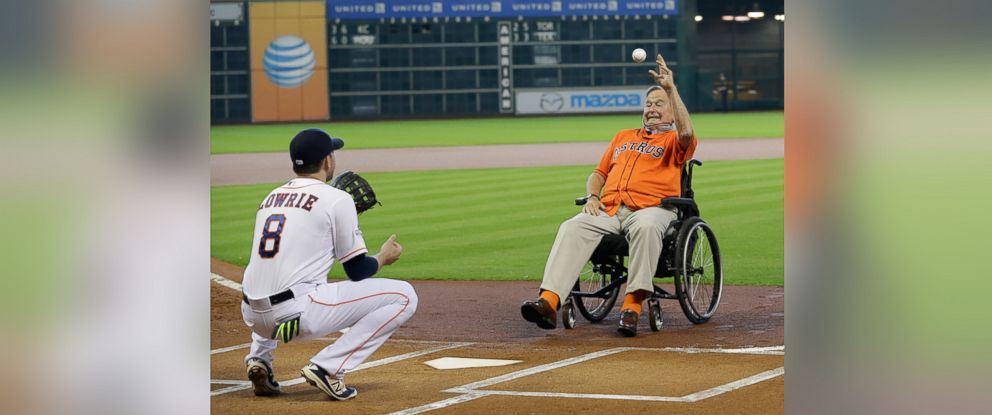 PHOTO: Former President George H.W. Bush throws out the ceremonial first pitch to Houston Astros Jed Lowrie (8) before Game 3 of baseballs American League Division Series between the Kansas City Royals and Houston Astros, Oct. 11, 2015, in Houston.