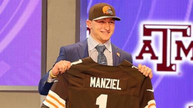 PHOTO: Johnny Manziel poses with his jersey after being selected by the Cleveland Browns at the 2014 NFL Draft at Radio City on Thursday, May 8th, 2014 in New York, N.Y.