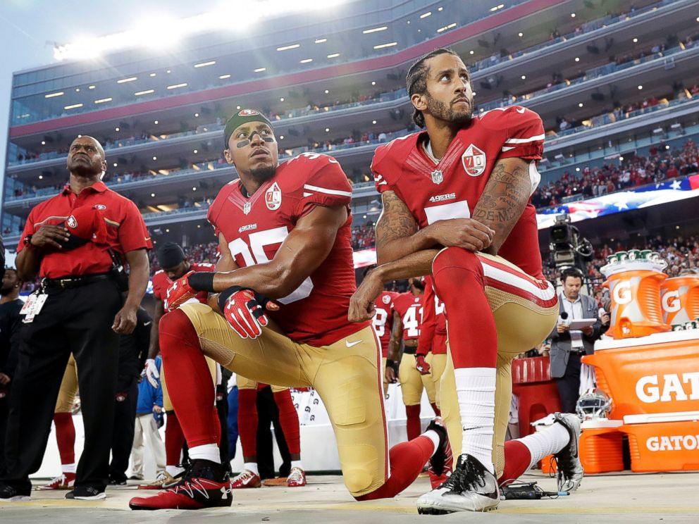 In this Monday, Sept. 12, 2016, file photo, San Francisco 49ers safety Eric Reid (35) and quarterback Colin Kaepernick (7) kneel during the national anthem before an NFL football game against the Los Angeles Rams.