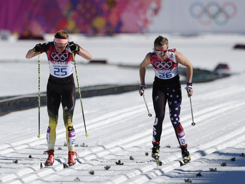 PHOTO: Germanys Nicole Fessel, left, and United States Sadie Bjornsen ski on the finish straight during the womens 10K classical-style cross-country race at the 2014 Winter Olympics, Feb. 13, 2014, in Krasnaya Polyana, Russia