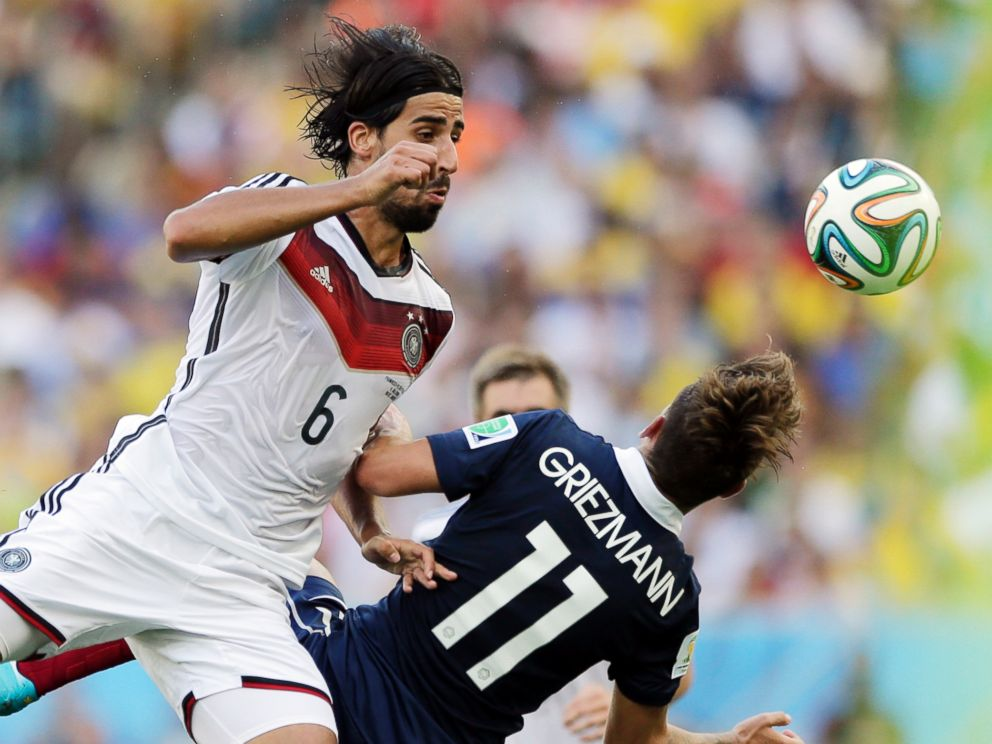 PHOTO: Germanys Sami Khedira heads the ball against Frances Antoine Griezmann during the World Cup quarterfinal soccer match at the Maracana Stadium in Rio de Janeiro, Brazil, July 4, 2014.