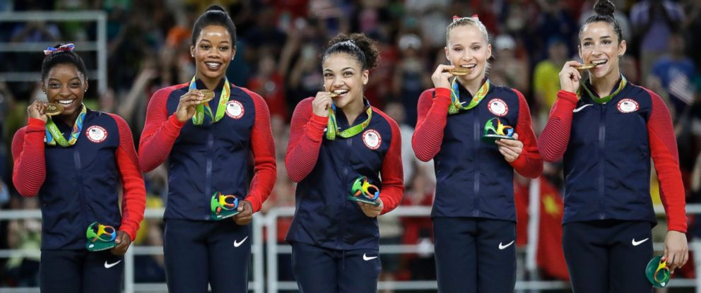 PHOTO: Simone Biles, Gabrielle Douglas, Lauren Hernandez, Madison Kocian and Aly Raisman hold their gold medals during the medal ceremony for the artistic gymnastics womens team at the 2016 Summer Olympics in Rio de Janeiro, Aug. 9, 2016.