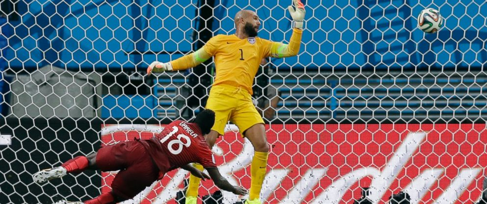 PHOTO: Portugals Silvestre Varela heads the ball past United States goalkeeper Tim Howard to score his sides second goal and tie the game 2-2 during the group G World Cup soccer match between the USA and Portugal at the Arena da Amazonia in Brazil.