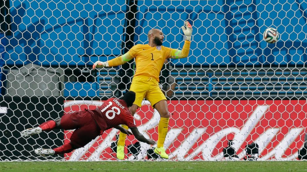 Portugal S Silvestre Varela Heads The Ball Past United States Goalkeeper Tim Howard To Tie