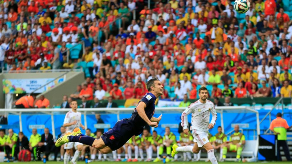 The Netherlands' Robin van Persie attempts the header that scored a goal during the soccer match between Spain and the Netherlands at the Arena Ponte Nova in Salvador, Brazil, June 13, 2014.