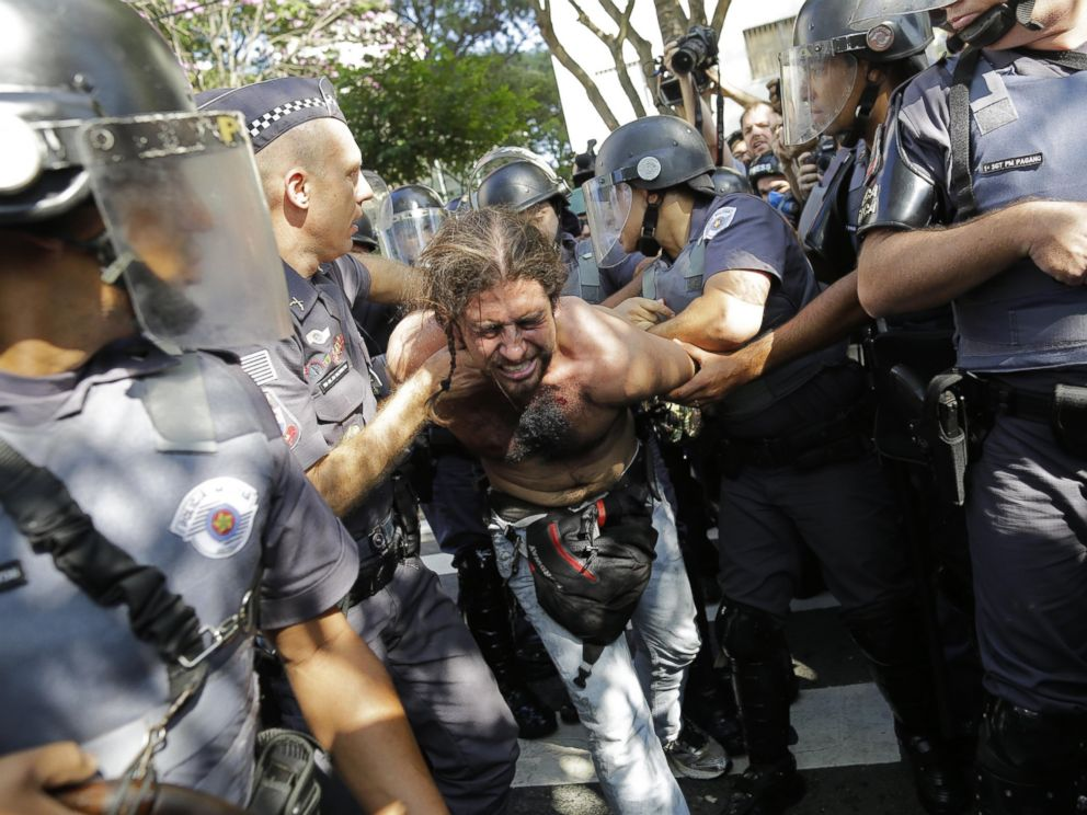 PHOTO: A protester is detained by police during a demonstration by people demanding better public services and against the money spent on the World Cup soccer tournament in Sao Paulo, Brazil, June 12, 2014.