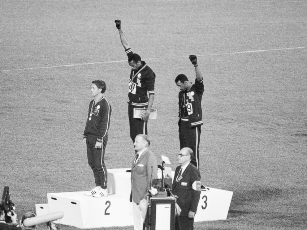 PHOTO: Tommie Smith and John Carlos, gold and bronze medalists in the 200-meter run at the 1968 Olympic Games, engage in a victory stand protest in 1968.