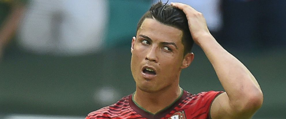 PHOTO: Portugals forward and captain Cristiano Ronaldo reacts after defeat in the Group G football match between Germany and Portugal at the Fonte Nova Arena in Salvador on June 16, 2014, during the 2014 FIFA World Cup.