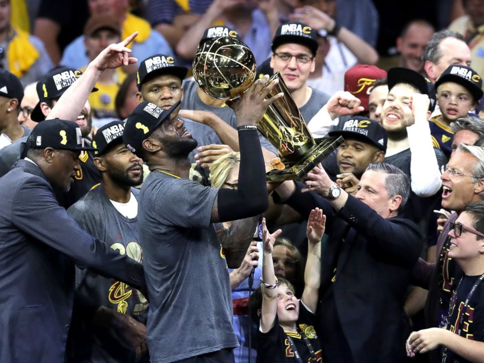 PHOTO: LeBron James of the Cleveland Cavaliers holds the Larry OBrien Championship Trophy after defeating the Golden State Warriors 93-89 in Game 7 of the 2016 NBA Finals at Oracle Arena on June 19, 2016 in Oakland, Calif.