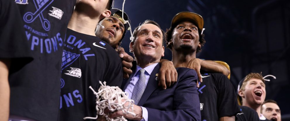 PHOTO: Head coach Mike Krzyzewski of the Duke Blue Devils stands with Grayson Allen, Quinn Cook and Justise Winslow after defeating Wisconsin in the NCAA Mens Final Four National Championship at Lucas Oil Stadium, April 6, 2015 in Indianapolis, Indiana.