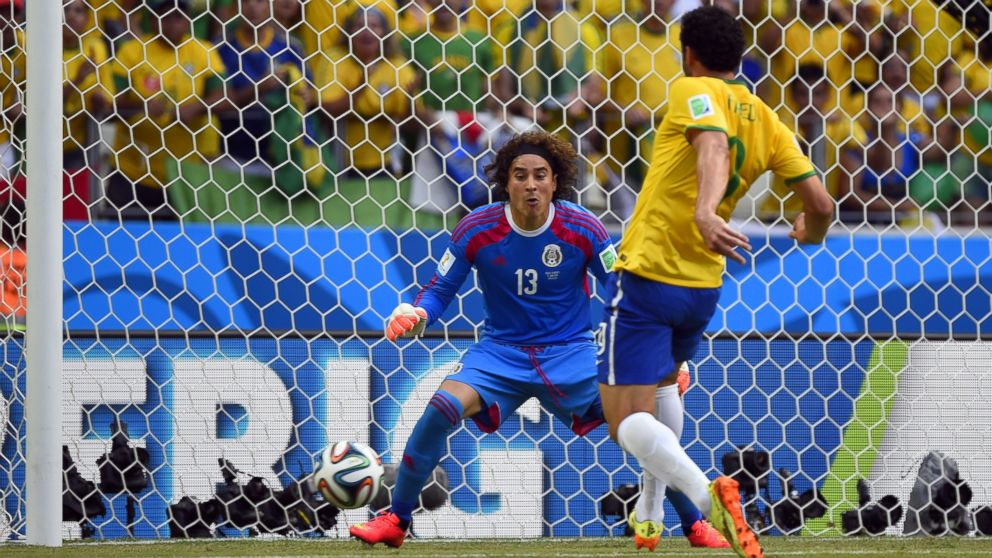 31483c82b Brazil s forward Fred (R) kicks the ball in front of Mexico s goalkeeper  Guillermo Ochoa