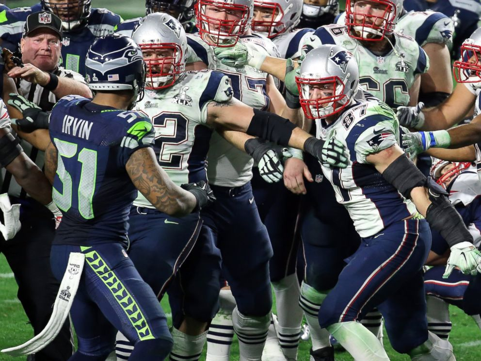 PHOTO: Bruce Irvin of the Seattle Seahawks and Rob Gronkowski of the New England Patriots exchange words late in the fourth quarter during Super Bowl XLIX at University of Phoenix Stadium, Feb. 1, 2015 in Glendale, Ariz.