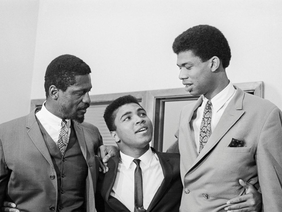 PHOTO: Bill Russell, left, Cassius Clay and Lew Alcindor, later Kareem Abdul-Jabbar, speak at a press conference rejecting US Army induction, June 1967.