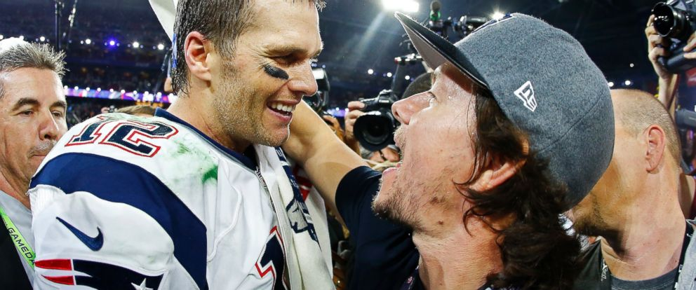 PHOTO: Tom Brady of the New England Patriots celebrates with Mark Wahlberg after defeating the Seattle Seahawks 28-24 to win Super Bowl XLIX at University of Phoenix Stadium, Feb. 1, 2015 in Glendale, Ariz.