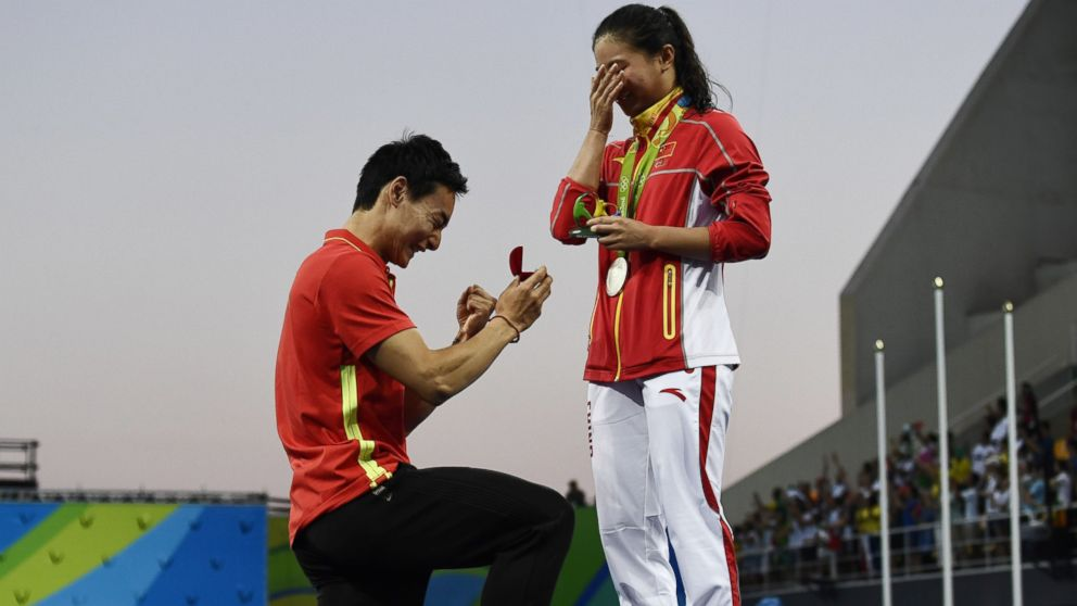 Silver medallist China's He Zi, receives a marriage proposal from Chinese diver Qin Kai during the podium ceremony of the Women's diving 3m Springboard Final at the Rio 2016 Olympic Games at the Maria Lenk Aquatics Stadium in Rio de Janeiro, Brazil, Aug. 14, 2016.