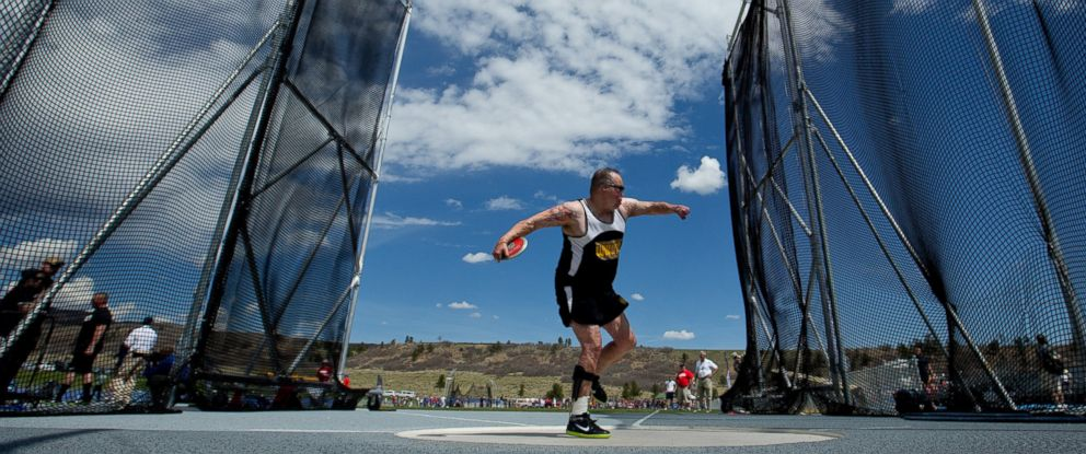 PHOTO: Israel Del Toro of the United States Special Operations Command competes in the standing discus during the Warrior Games, May 14, 2013, at Air Force Academy in Colorado.