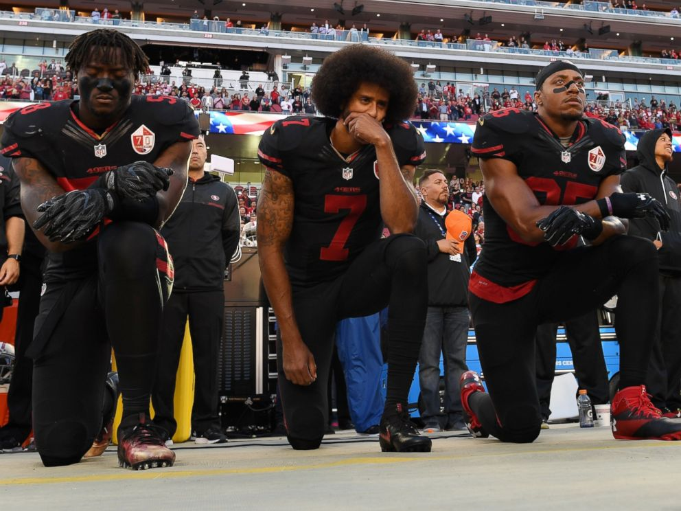 PHOTO: From left, Eli Harold, #58, Colin Kaepernick, #7, and Eric Reid, #35, of the San Francisco 49ers kneel in protest during the national anthem prior to their NFL game against the Arizona Cardinals, Oct. 6, 2016, in Santa Clara, California.