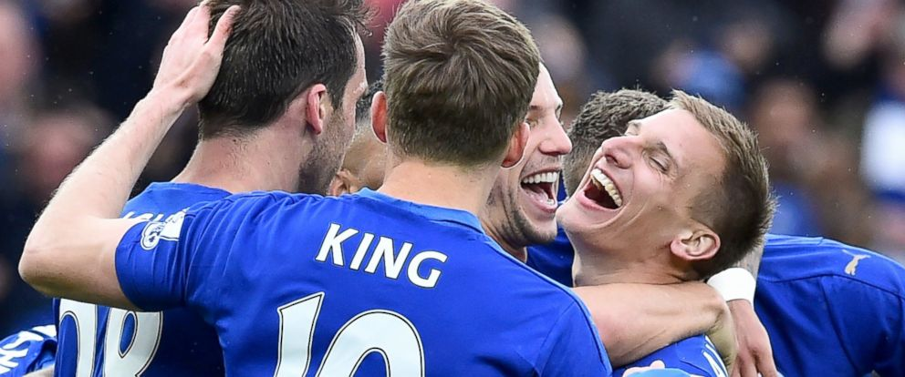 PHOTO: Leicester Citys English midfielder Marc Albrighton (R) celebrates scoring their fourth goal during the English Premier League football match between Leicester City and Swansea at King Power Stadium in Leicester, England, April 24, 2016.
