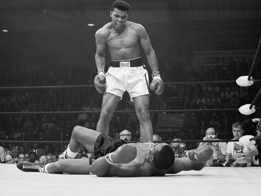PHOTO: Heavyweight champion Muhammad Ali stands over Sonny Liston and taunts him to get up during their title fight.