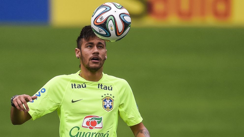 c3941c852e Neymar juggles with a ball during a training session of the Brazilian  national football team at