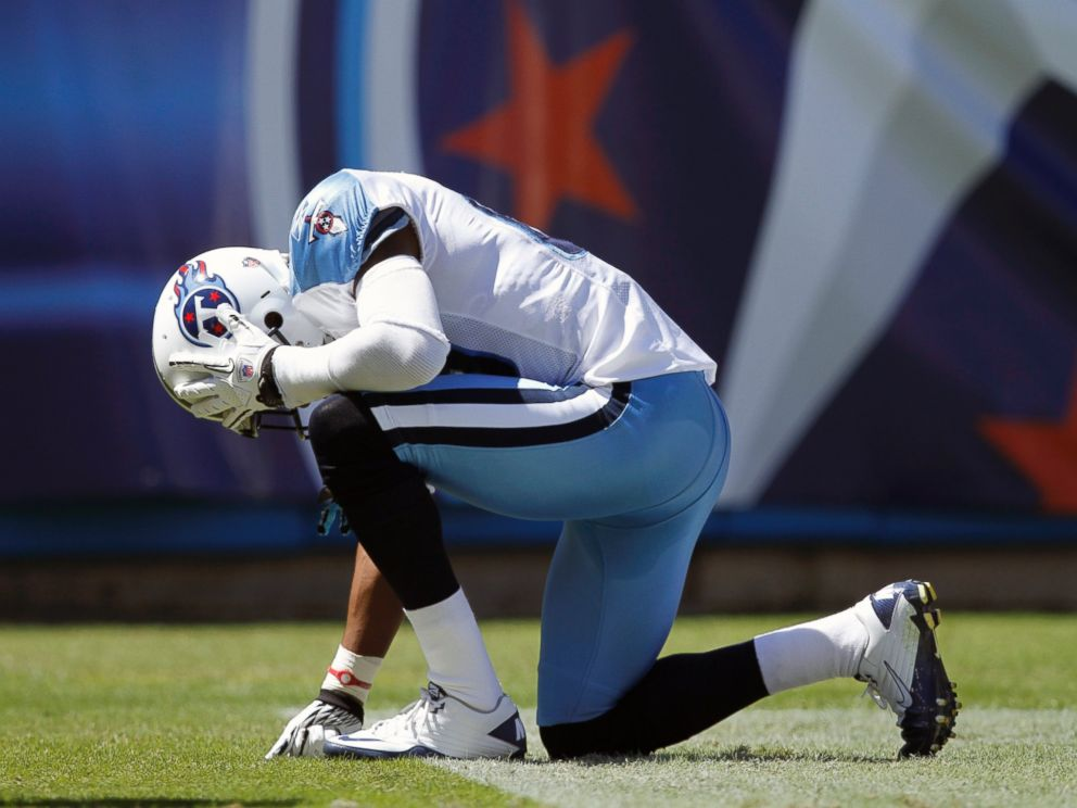 PHOTO: Nate Washington #85 of the Tennessee Titans kneels down after catching a touchdown pass in the first half against the Oakland Raiders during the NFL season opener at LP Field, Sept. 12, 2010, in Nashville, Tenn.