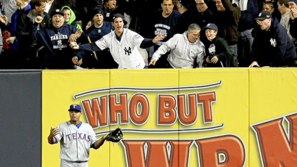 PHOTO: Nelson Cruz of the Texas Rangers reacts to a home run ball hit by Robinson Cano of the New York Yankees in the bottom of the second inning of Game 4 of the ALCS during the 2010 MLB Playoffs at Yankee Stadium in New York, Oct. 19, 2010.