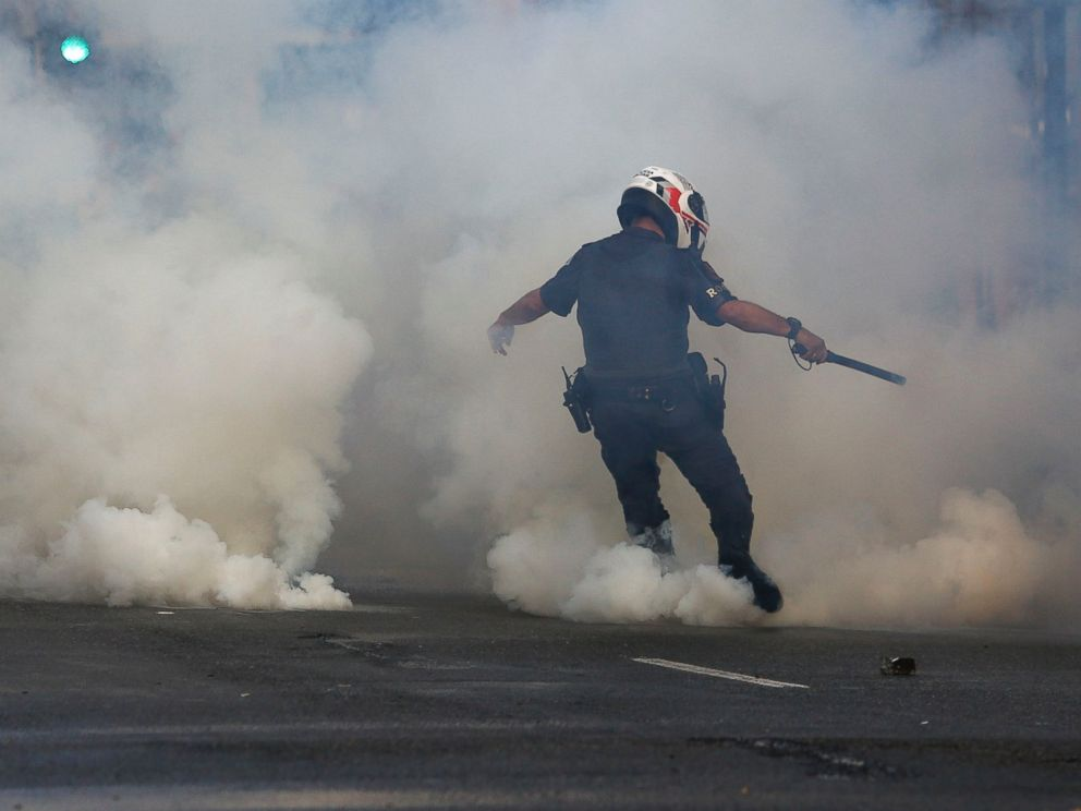 PHOTO: A policeman kicks a tear gas canister as supporters of Brazilian suspended President Dilma Rousseff protest against interim president Michel Temer, in Sao Paulo, Brazil, June 1, 2016.