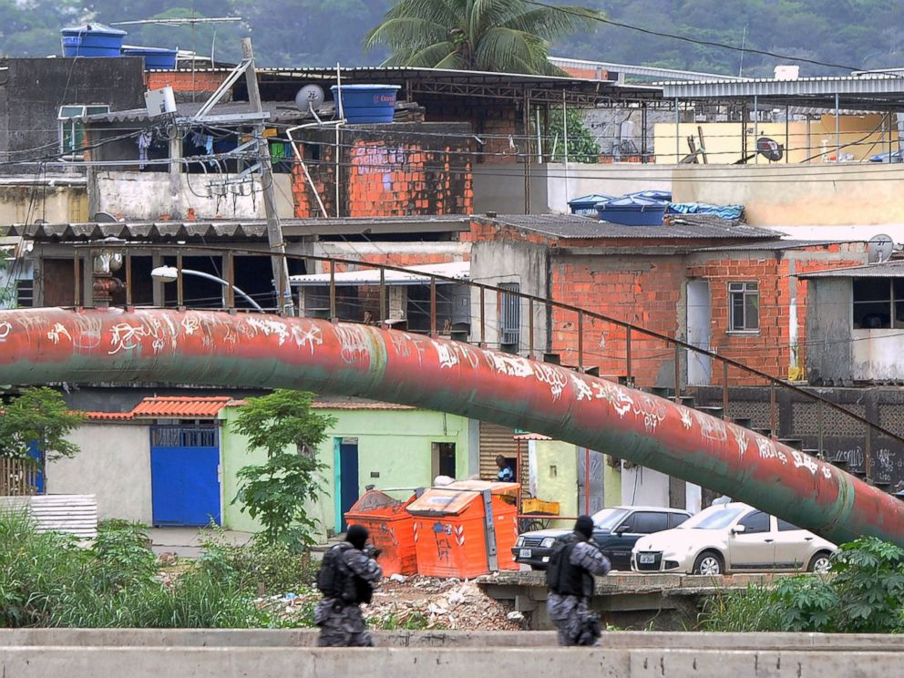 PHOTO: PM paramilitary police personnel man a checkpoint on a bridge in the Cidade de Deus shantytown, 10km from the Olympic Village Rio de Janeiro, Brazil, July 21, 2016.