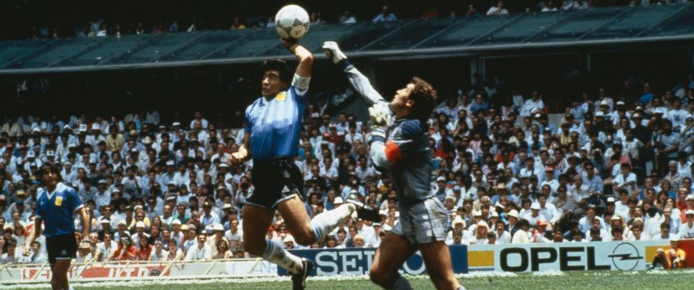 """PHOTO: Argentinas Diego Maradona scores with his """"Hand of God,"""" past England goalkeeper Peter Shilton on June 22, 1986 in Mexico."""
