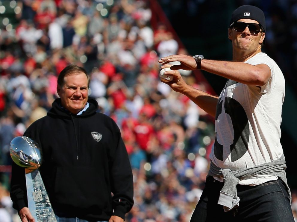 PHOTO: Patriots quarterback Tom Brady, right, threw out the ceremonial first pitch at the Boston Red Sox home opener, as Bill Belichick, left, looks on in Boston on April 13, 2015.