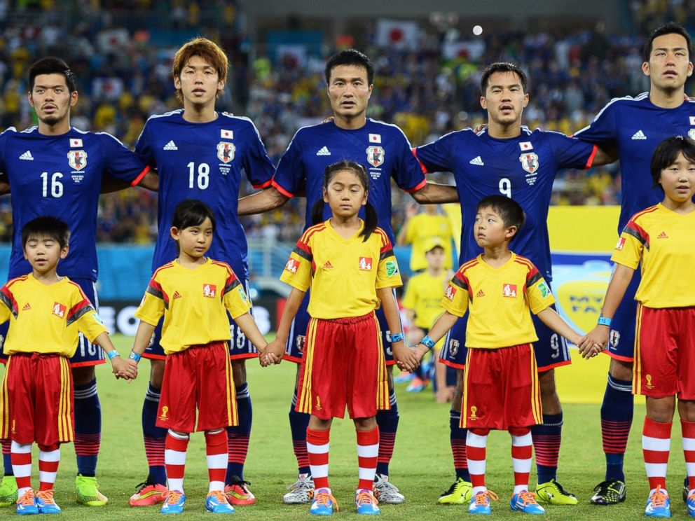 PHOTO: Left to right, Hotaru Yamaguchi, Yuya Osako, Yasuyuki Konno, Shinji Okazaki and Maya Yoshida of Japan sing the National Anthem during the 2014 FIFA World Cup Brazil Group C match between Japan and Greece.