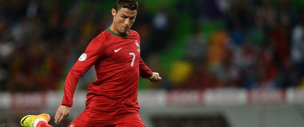 PHOTO: Portugals midfielder Cristiano Ronaldo kicks the ball