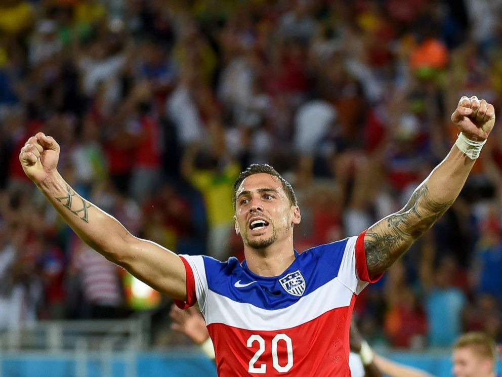 PHOTO: US defender Geoff Cameron celebrates after US defender John Brooks scored during a Group G football match between Ghana and US at the Dunas Arena in Natal during the 2014 FIFA World Cup, June 16, 2014.