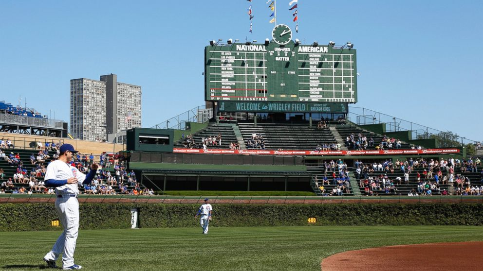 Players warm up before a game between the Chicago Cubs and Pittsburgh Pirates at Wrigley Field in Chicago, Sept. 14, 2012.