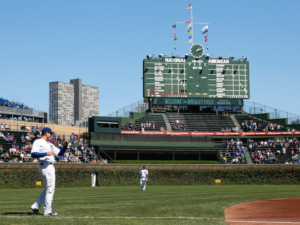 PHOTO: Players warm up before a game at Wrigley Field