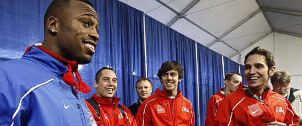 PHOTO: Professional football player Vernon Davis, left, is joined by Team USA Curling at the 2010 Olympic Winter Games in Vancouver, British Columbia, Canada.