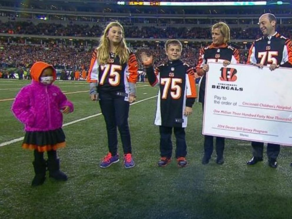 Leah Still, 4, participates in a ceremony during her fathers NFL game in Cincinnati, Ohio, on November 6, 2014. The Cincinnati Bengals donated all the proceeds from Devon Stills jersey sales to the Cincinnati Childrens Hospital Medical Center.