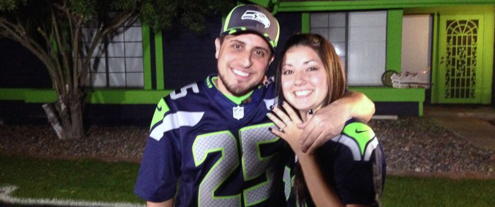 PHOTO: Seahawks fan Ashtin Fitzwater proposed to his girlfriend Melissa in front of the house he recently painted in the teams colors.