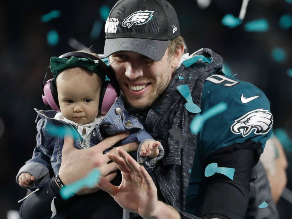 PHOTO: Philadelphia Eagles Nick Foles holds up his daughter, Lily after the NFL Super Bowl 52 football game against the New England Patriots, Feb. 4, 2018, in Minneapolis.
