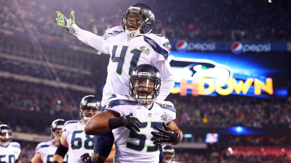 531219003 Seattle Seahawks outside linebacker Malcolm Smith (53) and cornerback Byron  Maxwell (41)