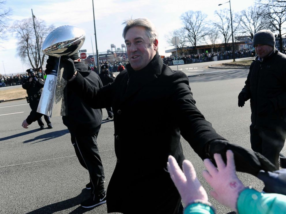 PHOTO: Philadelphia Eagles head coach Doug Pederson walks along the parade route with the Lombardi Trophy during the Super Bowl LII victory parade, Feb 8, 2018, in Philadelphia.