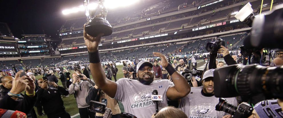 PHOTO: Philadelphia Eagles Fletcher Cox holds the George Halas Trophy after the NFL football NFC championship game against the Minnesota Vikings, Jan. 21, 2018, in Philadelphia. The Eagles won 38-7 to advance to Super Bowl LII.