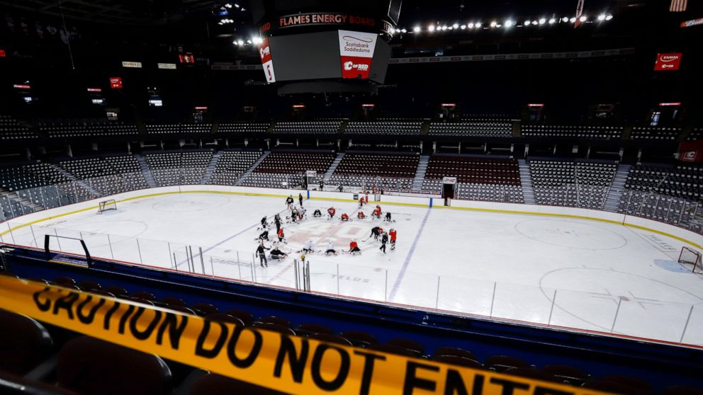 Pucks And Masks Prevalent As 24 Nhl Teams Open Training Camp Abc News